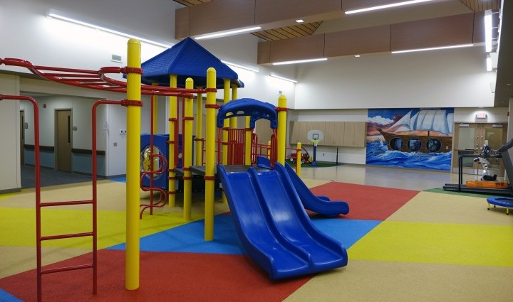 The indoor playground and physical therapy area in the secure pediatric unit.