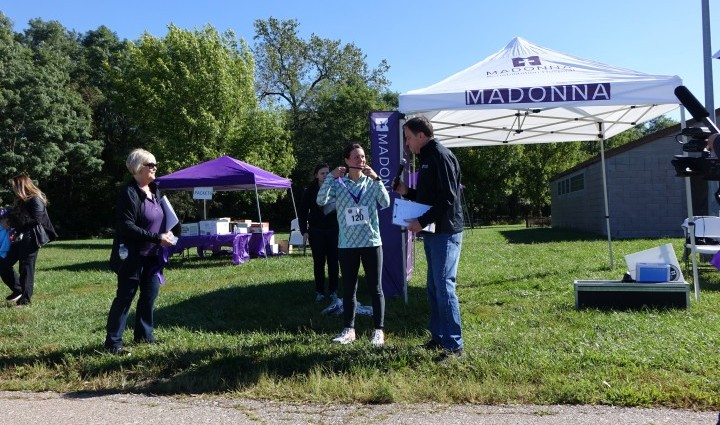 Ky'Lee Baumert, Madonna Physical Therapist, won the women's division with a time of 22:05.