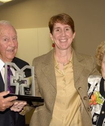 Award winner, Richard W. Chapin (left) and his wife, Jacqueline (right), holding the Innovation Award presented by Dr. Judith Burnfield, director of Madonna's Research Institute.