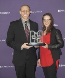Lawrence Chatters (left) with his wife, Katie, accepting the Innovation Award on behalf of the Goldwin Foundation