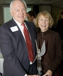 Ken Korff (left) presented the Crystal Angel Award in honor of their brother Glenn Korff, alongside friend and Madonna Supporter, Mary Arth.