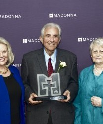 Anthony Acone (middle) accepting the 2017 Vision Award with (from left) his wife, Sandra, and Linda Childears from the Daniels Fund.
