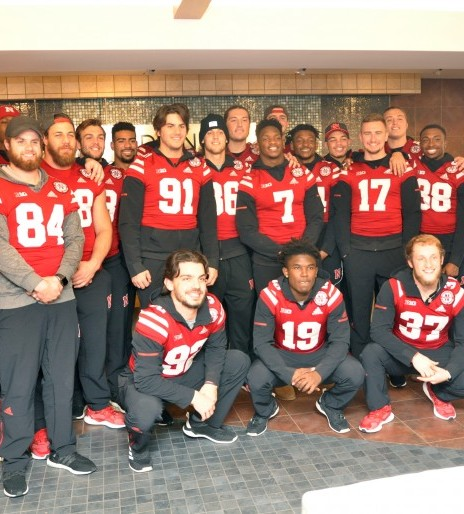 Husker football players visit brightens day for Madonna patients