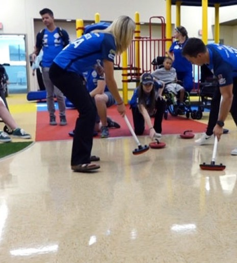 Curling athletes visit Madonna Omaha Campus patients