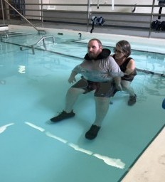 Sports coach motivated by small gains one year after spinal cord injury