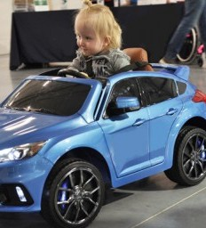 Young boy with spina bifida receives modified electric car