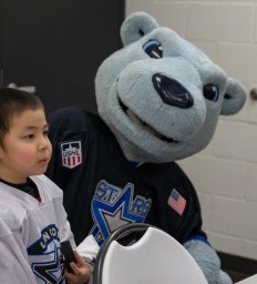 Young hockey fan returns to ice after battling rare illness