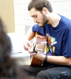 Former patient fulfills promise of playing guitar for care team