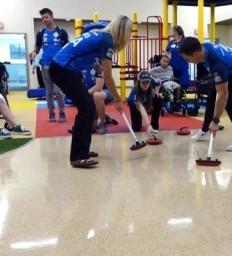 Curling athletes visit Madonna Omaha Campus patients